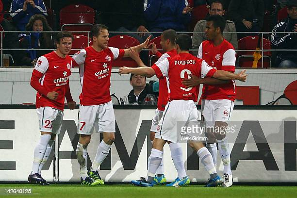 Eugen Polanski celebrates his team's first goal with team mates during the Bundesliga match between between FSV Mainz 05 and 1 FC Koeln at Coface...