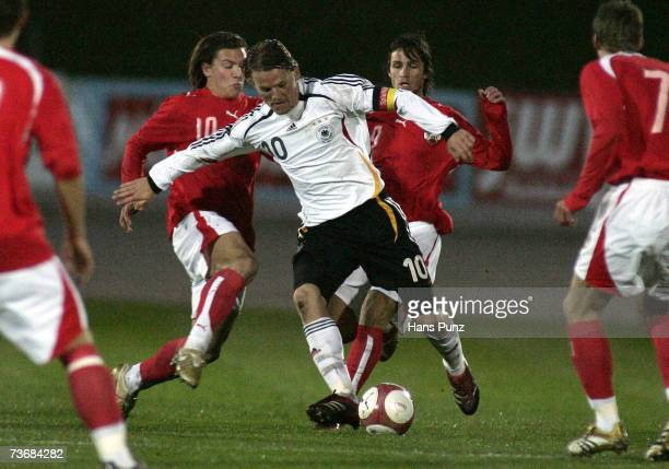 Eugen Polanski from Germany and Marko Stankovic and Emin Sulimani of Austria battle for the ball during the Men's U21 international friendly match...