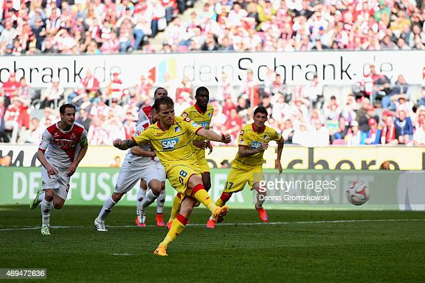 Eugen Polanski of 1899 Hoffenheim scores their first goal from a penalty during the Bundesliga match between 1. FC Koeln and 1899 Hoffenheim at...