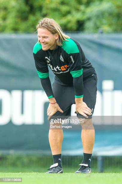 Eugen Polanski of Borussia Moenchengladbach smiles during day 4 of the pre-season summer training camp of Borussia Moenchengladbach on August 20,...