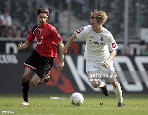 Eugen Polanski of Boruusia and Thomas Brdaric of Hanover fights for the ball during the Bundesliga match between Borussia Monchengladbach and Hanover...