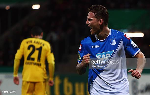 Eugen Polanski of Hoffenheim celebrates his team's first goal during the DFB Cup Round of 16 match between VfR Aalen and 1899 Hoffenheim at Scholz...