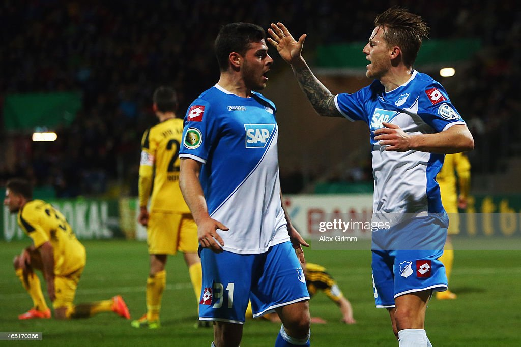 Eugen Polanski (R) of Hoffenheim celebrates his team's first goal with team mate Kevin Volland during the DFB Cup Round of 16 match between VfR Aalen and 1899 Hoffenheim at Scholz Arena on March 3, 2015 in Aalen, Germany.