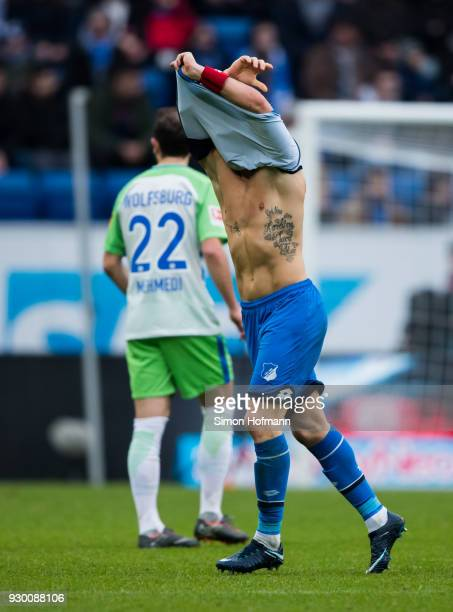 Eugen Polanski of Hoffenheim is removing his damaged jersey to replkace it with a new one during the Bundesliga match between TSG 1899 Hoffenheim and...