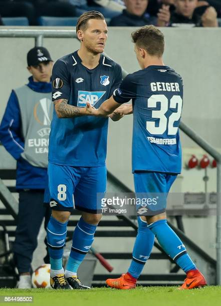 Eugen Polanski of Hoffenheim shakes hands with Dennis Geiger of Hoffenheim during the UEFA Europa League Group C match between 1899 Hoffenheim and...