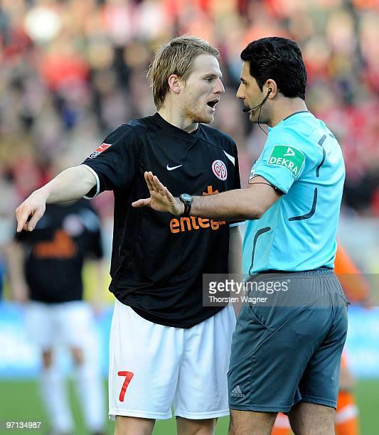 Eugen Polanski of Mainz argues with referee Babak Rafati during the Bundesliga match between FSV Mainz 05 and SV Werder Bremen at Bruchweg Stadium on...