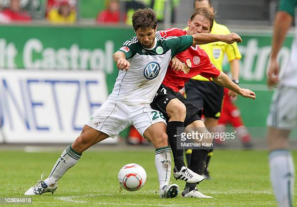 Eugen Polanski of Mainz battles for the ball with Diego Ribas da Cunha of Wolfsburg during the Bundesliga match between VFL Wolfsburg and FSV Mainz...