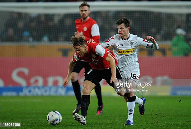 Eugen Polanski of Mainz is chased by Havard Nordtveit of Moenchengladbach during the Bundesliga match between Borussia Moenchengladbach and FSV Mainz...