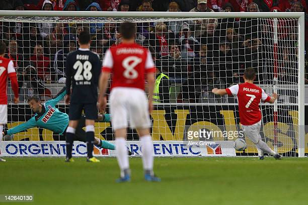 Eugen Polanski of Mainz scores his team's first goal with a penalty against goalkeeper Michael Rensing of Koeln during the Bundesliga match between...