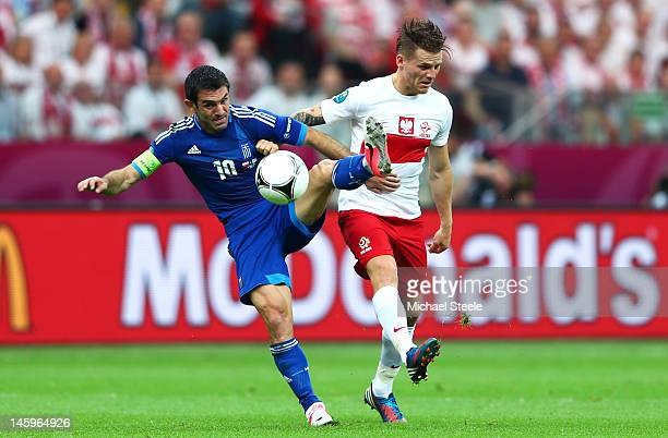 Eugen Polanski of Poland and Giorgos Karagounis of Greece battle for the ball during the UEFA EURO 2012 group A match between Poland and Greece at...