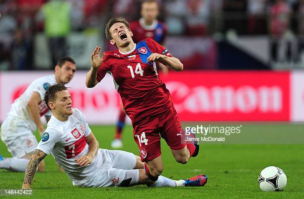 Eugen Polanski of Poland brings down Vaclav Pilar of Czech Republic during the UEFA EURO 2012 group A match between Czech Republic and Poland at The...