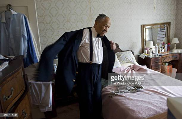 Eugene Allen a retired White House butler who has served eight presidents tries on his old tuxedo for a photo for the Washington Post