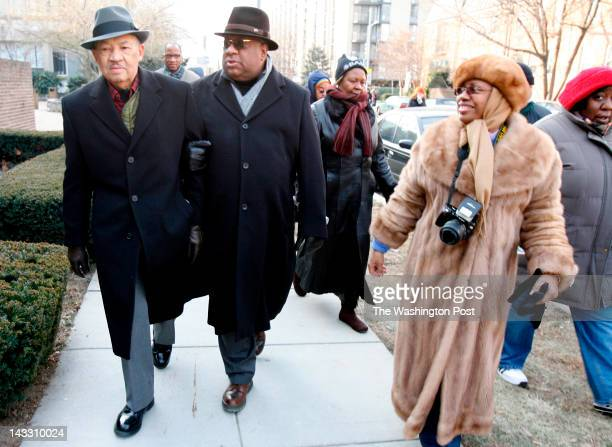 Eugene Allen son Charles Allen and Ortaciana Allen make their way to the Capitol Building for the inauguration of Barack Obama Tuesday afternoon...