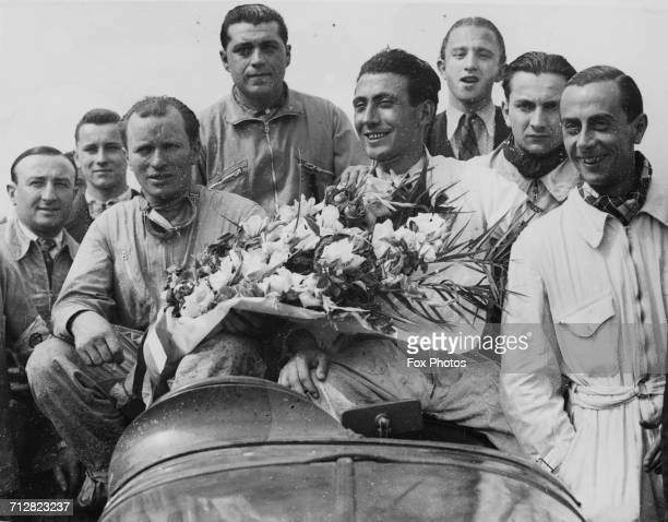 Eugene Chaboud and Jean Tremoulet of France drivers of the Delahaye 135CS celebrate winning the World Sportscar Championship 24 Hours of Le Mans race...