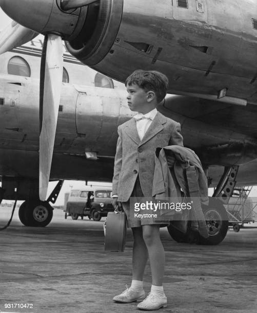Eugene Chaplin the son of filmmaker Charlie Chaplin and Oona O'Neill arrives at London Airport with three other family members for a holiday in...