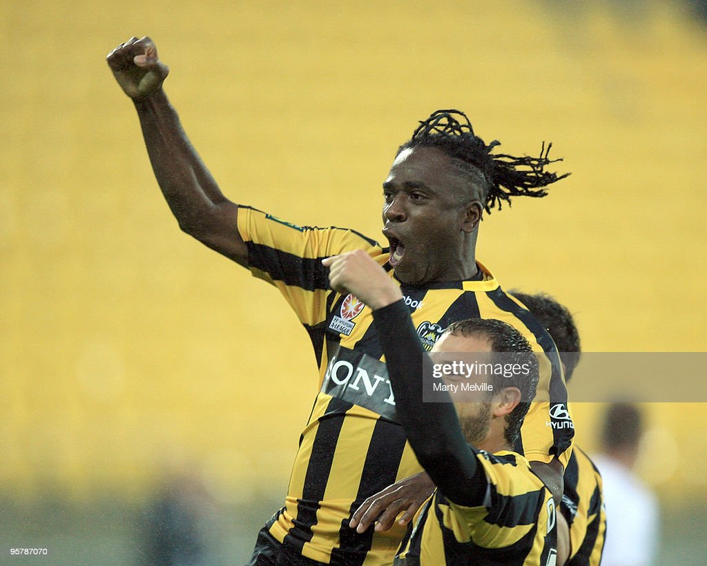 Eugene Dadi and Andrew Durante captain of the Phoenix celebrates Dadi's goal during the round 23 A-League match between the Wellington Phoenix and North Queensland Fury at Westpac Stadium on January 15, 2010 in Wellington, New Zealand.