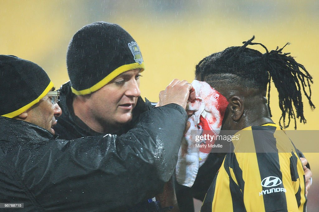 Eugene Dadi of the Phoenix gets attention after a clash with Matthew Smith of the Roar injuring Dadi during the round 23 A-League match between the Wellington Phoenix and North Queensland Fury at Westpac Stadium on January 15, 2010 in Wellington, New Zealand.