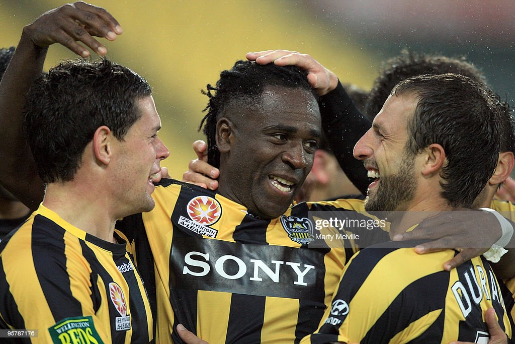 Eugene Dadi, Troy Hearfield and Andrew Durante captain of the Phoenix celebrates a goal during the round 23 A-League match between the Wellington Phoenix and North Queensland Fury at Westpac Stadium on January 15, 2010 in Wellington, New Zealand.