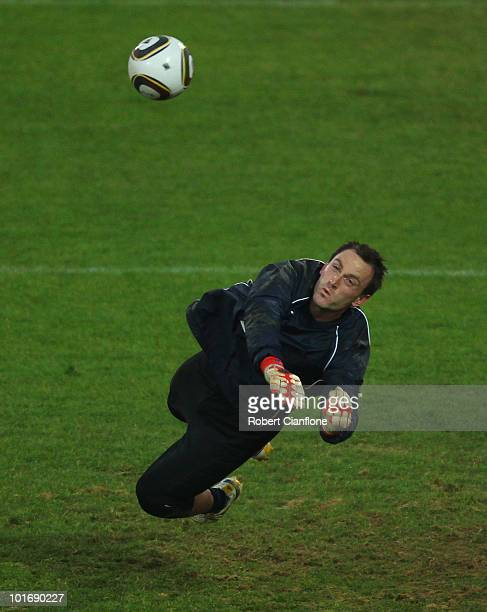 Eugene Galekovic dives for the ball during an Australian Socceroos training session at Ruimsig Stadium on June 7 2010 in Roodepoort South Africa