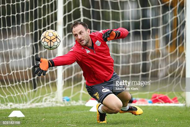 Eugene Galekovic makes a save during an Adelaide United ALeague training session at the Adelaide United Training Centre on April 28 2016 in Adelaide...