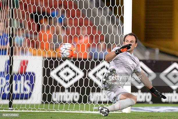Eugene Galekovic of Adelaide is unable to save a penalty goal by Henrique of the Roar during the round 16 ALeague match between the Brisbane Roar and...