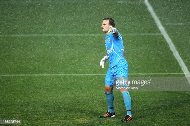 Eugene Galekovic of Adelaide reacts as the rain comes down during the round 14 A-League match between Adelaide United and the Brisbane Roar at...