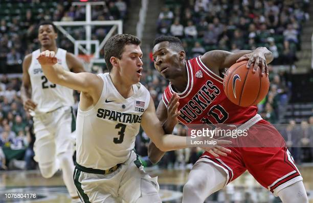Eugene German of the Northern Illinois Huskies drives the ball to the basket as Foster Loyer of the Michigan State Spartans defends during the second...