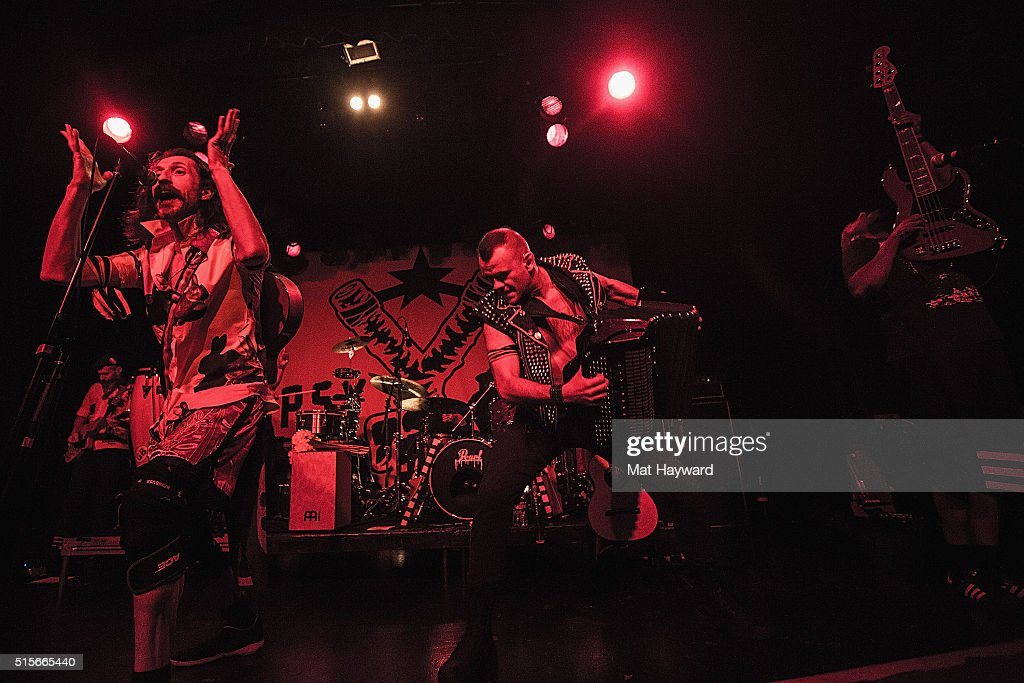 Eugene Hutz, Pasha Newmer and Sergey Ryabtzev of Gogol Bordello perform on stage at The Showbox on March 14, 2016 in Seattle, Washington.