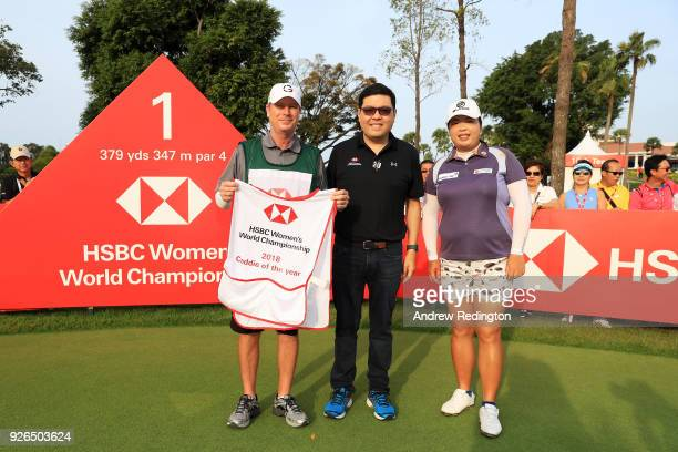Eugene Kwek Head of Marketing Retail Banking and Wealth Management HSBC Singapore presents the caddie of the year award to Mercer Leftwich caddie for...