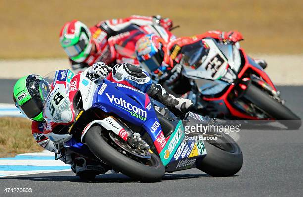 Eugene Laverty of Ireland and Voltcom Crescent Suzuki leads Marco Melandri of Italy and Aprilia Racing Team in race 1 during round one of the 2014...