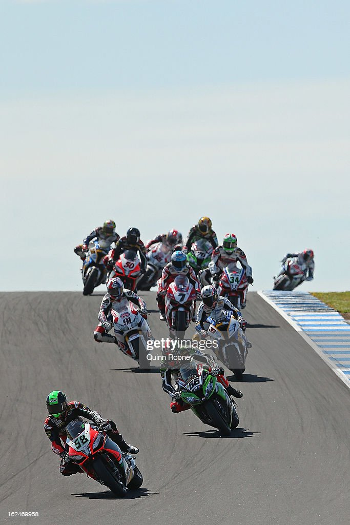 Eugene Laverty of Ireland riding the #58 Aprilia Racing Team leads the field during the World Superbikes Race One at Phillip Island Grand Prix Circuit on February 24, 2013 in Phillip Island, Australia.