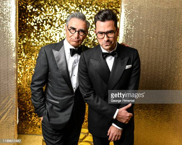 Eugene Levy and Dan Levy pose inside the 2019 Canadian Screen Awards Portrait Studio held at Sony Centre for the Performing Arts on March 31, 2019 in...
