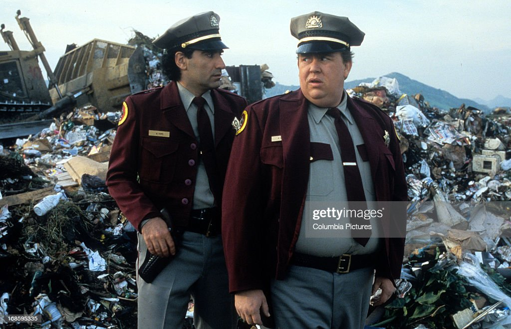Eugene Levy and John Candy dressed in security guard uniforms while