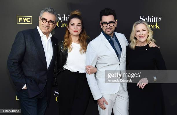 "Eugene Levy, Annie Murphy, Daniel Levy and Catherine O'Hara arrive at the FYC Screening of Pop TV's ""Schitt's Creek"" at the Saban Media Center on May..."