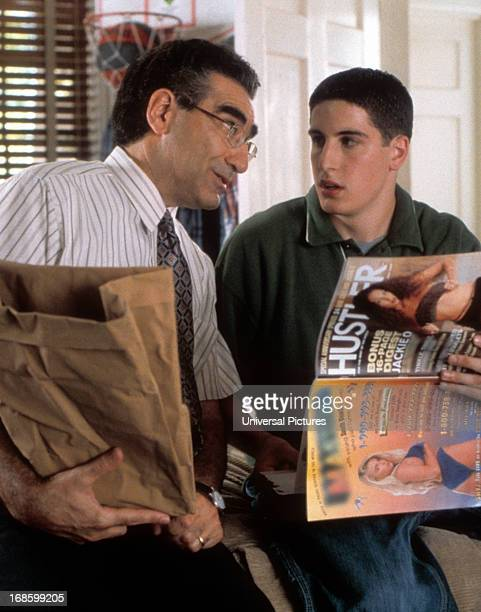 Eugene Levy having awkward conversation with Jason Biggs over Hustler Magazine in a scene from the film 'American Pie' 1999