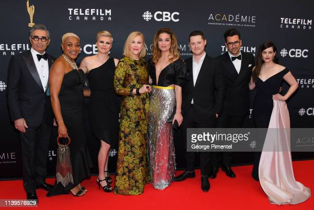 Eugene Levy Karen Robinson Jennifer Robertson Catherine O'Hara Annie Murphy Noah Reid Dan Levy and Emily Hampshire from Schitt's Creek attend the...