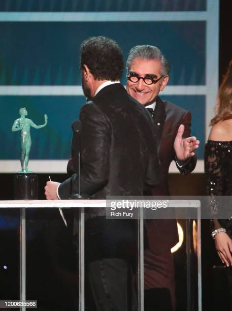 Eugene Levy presents Tony Shalhoub with the Outstanding Performance by a Male Actor in a Comedy Series for 'The Marvelous Mrs Maisel' onstage during...