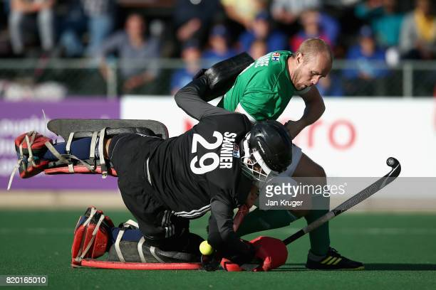 Eugene Magee of Ireland and Coretin Saunier of France compete in a penalty shoot out during the 5th8th place play off match between Ireland and...