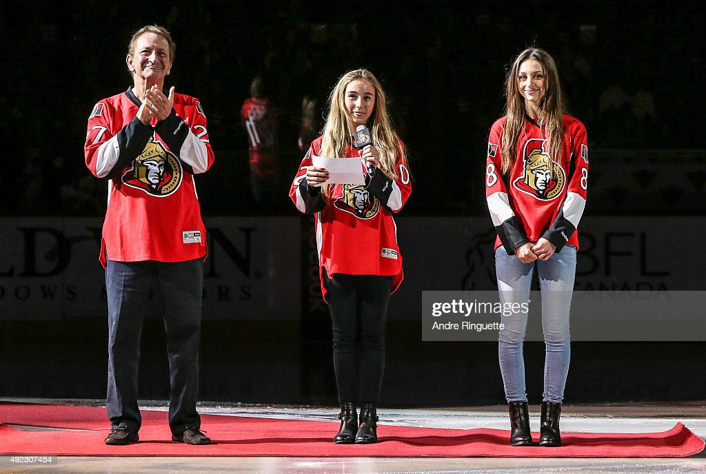 Eugene Melnyk, owner of the Ottawa Senators, participates in a pre game ceremony with his daughters prior to the home opener against the Montreal Canadiens at Canadian Tire Centre on October 11, 2015 in Ottawa, Ontario, Canada.