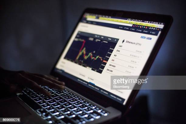 Eugene Mutai bitcoin 'miner' and software developer uses a laptop computer to view a web based trading screen for Ethereum cryptocurrency in Nairobi...