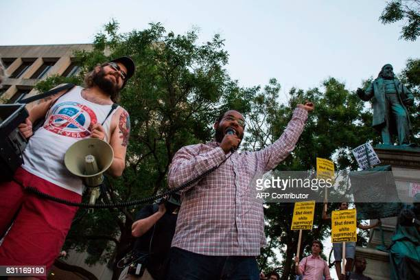 Eugene Puryear speaks in front of a statue of Confederate General Albert Pike on August 13 2017 in Washington DC the only member of the Confederate...
