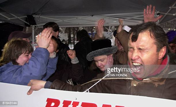 Eugene Roos Michelle Culbertson and other supporters of four New York City police officers on trial for murder celebrate outside the Albany County...