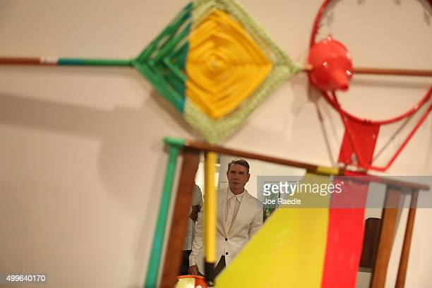 Eugene Sadovoy checks out the Jessica Stockholder's art installation titled 'Crux of the Matter' on display during the opening day of Art Basel on...