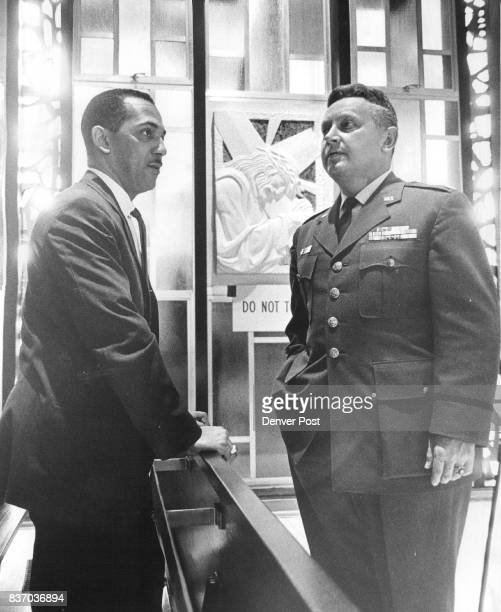 Eugene Steward left of the Chief Air Force Chaplain's Office Washington DC discusses Catholic Chapel outfitting with Lt Col RA Weekley of the Academy...