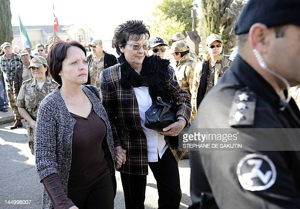 Eugene Terre'Blanche's widow Martie and her daughter arrive at the Ventersdorp Magistrate court on May 22 before the verdict in the murder trial of...