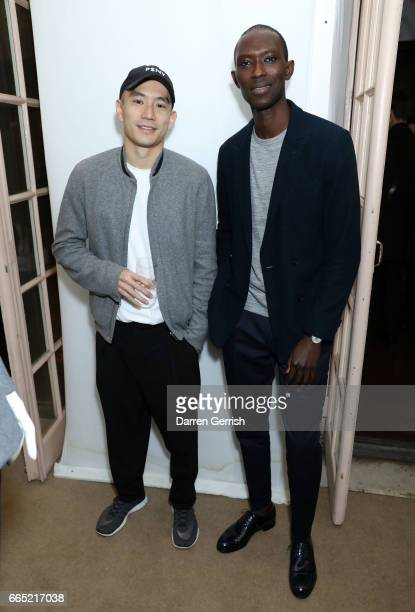 Eugene Tong and Armando Cabral attends the Matchesfashioncom 30th Anniversary Dinner on April 5 2017 in New York City
