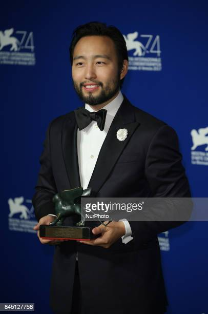 Eugene YK Chung poses with the Best VR Experience Award for 'La Camera Insabbiata' codirected with Laurie Anderson at the Award Winners photocall...