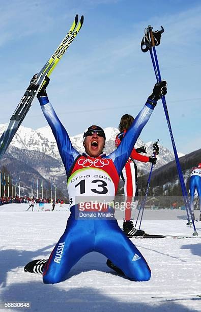 Eugeni Dementiev of Russia celebrates winning the Gold Medal after victory in the Mens Cross Country Skiing 30km Pursuit Final on Day 2 of the 2006...