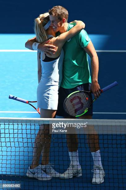 Eugenie Bouchard and Vasek Pospisil of Canada celebrate winning their mixed doubles match against Daria Gavrilova and Thanasi Kokkinakis of Australia...