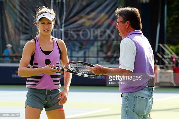 Eugenie Bouchard of Canada and her coach Jimmy Connors talk on the practice court prior to the 2015 US Open at USTA Billie Jean King National Tennis...